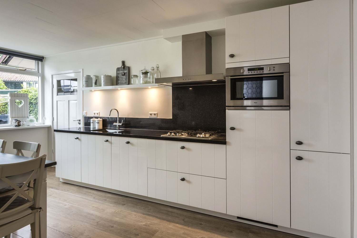 Keukenstijlen krijg informatie en inspiratie en bekijk vele voorbeelden ardi - Foto grijze keuken en hout ...